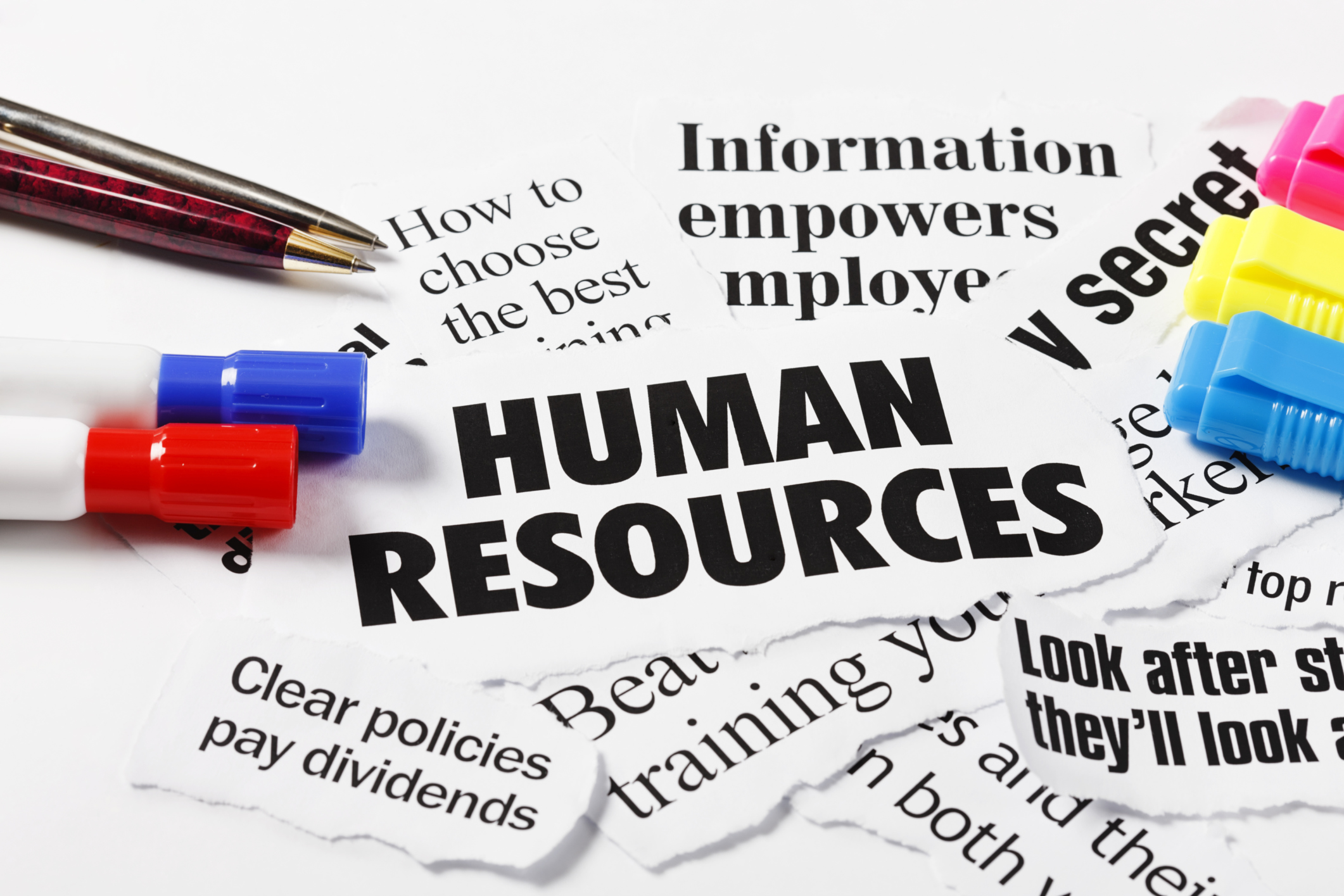 Headlines on Human Resources and employment issues, with pens